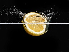 Lemon splash  Cannon 18-55 kit lens @55 f/22 Iso 200 1/250second  Speedlight overhead @1/128th power (in a dark room giving effective exposure of 1/20000 second (Sublime Visuals) Tags: highspeed photography cannon 1855 18503556 kitlens creative stilllife ideas bored dramatic drama science physics lemon water waterdrops freeze action splash slowmotion capture refreshing interesting fruit food foodphotography yummy nice interest