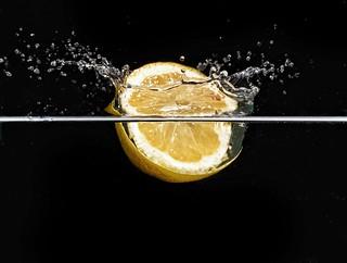 Lemon splash  Cannon 18-55 kit lens @55 f/22 Iso 200 1/250second  Speedlight overhead @1/128th power (in a dark room giving effective exposure of 1/20000 second
