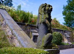 The Lister Lion (rustyruth1959) Tags: nikon nikond3200 tamron16300mm yorkshire calderdale halifax shibdenhall shibdenpark listerlion listerlionstatue lionstatue lion statue stone stonelion millstonegrit outdoor plinth wall path animalstatue flowers gardens trees sky shrub hedge mane body stolen theft annelister listerfamily moss