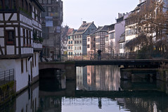 The Water Watcher - original version (Dan Daniels) Tags: cityscapes water nikon alsace strasbourg france rivers canals reflections waterreflections