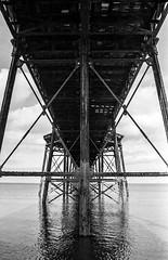 The Iron Pier 4 (-DiscoGilly-) Tags: bw canon canona1 rolleiretro asa100 beach sea sand pier iron ironpier film bwfp 28mm 35mm analog