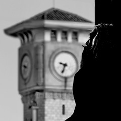 Clochard (heinzkren) Tags: schwarzweis sw bw blackandwhite biancoetnero noiretblanc monochrome urban candid time clock tower clocktower street streetphotography cigarette zigarette nice nizza turm turmuhr panasonic lumix silhouette france frankreich mann man people person flair stimmung milieu mood portrait square