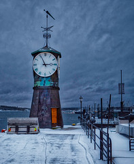 Oslo, Norway (designcover2006) Tags: clock downtown no person time architecture travel oslo norway snow tower sky city landscape building sunset water river outdoors evening canon