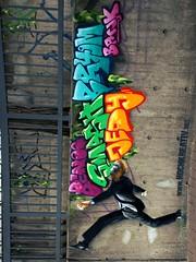July 20, 1969: One Giant Leap For Mankind (pix-4-2-day THANX for 1 m views) Tags: stencil graffiti raschplatz andreashermesplatz hannover hanover bahnhof passerelle nikidesaintphallepromenade street art strasenkunst affe ape monkey mask maske tiermaske geländer beton concrete tags colours colourful bunt jump leap sprung schritt step man mann suit anzug schwarz black schimpanse chimpanzee chimp wwwhochkreativorg graffito green grün purple lila pink blau blue