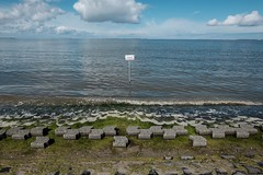 Attention! Danger of slipping! (gambajo) Tags: attention danger slipping sign water sea coast beach stones sky ostfriesland wave waves