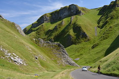 Tough Climb, Winnats Pass, Peak District National Park Derbyshire, England. (westport 1946) Tags: england unitedkingdom nationalpark thenationaltrust highpeak peakdistrict castleton derbyshire winnatspass bluesky ridge limestone limestonepinnacles rockformation rocks road car cylist bicicletas biciclette bicycle bicicletta cycle hillside hills hill foothill grass grasslands valley gorge countryside rural landscape outdoor peaceful tranquil idyllic serene limestonecleft cyclinguphill toughclimb silvercar