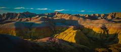 Badlands National Park (phillipjv) Tags: badlands park sky sun yellow mounds land landscape red blue clouds dakota south nature america beauty magenta