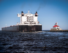American Century Laker and the Lighthouse, Canal Park, Duluth (Sharon Mollerus) Tags: greatlakes duluth lakesuperior lighthouse shipping minnesota unitedstates us