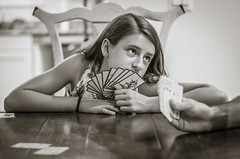 P1100418 Please Don't Play that Card, Dad! (Steve's Outtakes) Tags: girl child kid eyes pleading cards game bw blackandwhite journalism daughter