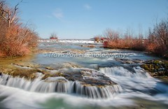Long exposure exterior daytime photo of mini waterfall on Goat Island at Niagara Falls with blue sky background. (Travis Powers Photography) Tags: goatisland longexposure niagarafalls westernnewyork waterfall canada