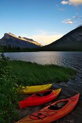 Sailing at dusk (Adam Wang) Tags: landscape lake sunset canoe peaceful colorful dusk lakes tranquil serenity banff scenic vermilion sunray mountain lakeside reflection bivouac mtrundle travel