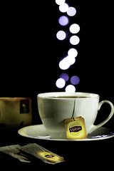 Lipton tea bokeh (~trigger_happy~) Tags: lipton tea bokeh lights dark canon 100mm macro wow
