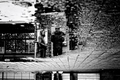 Reflections (*Chris van Dolleweerd*) Tags: woman girl puddle water reflection bw street streetphotography chrisvandolleweerd fujifilm