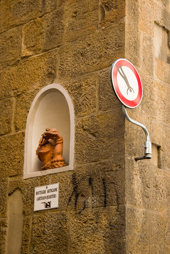 A street sign created by Clet Abraham in Florence, Italy