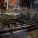 Ercolano (Herculaneum) - Casa del Tramezzo di Legno - Letto (Charred bed)