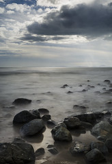 Long exposure of sea and rocks (RedPlanetClaire) Tags: wales shellisland welsh uk coast sea island long exposure shutterspeed rocks smooth water evening