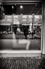 Hear Me Calling (Alfred Grupstra) Tags: blackandwhite urbanscene citylife city street architecture restaurant people store cafe builtstructure buildingexterior mobilestock monochrome outdoors sidewalk hoorn reflection