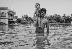 Parental Care (Avishek Das Photography) Tags: struggle flood people life
