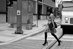 Big Shoes To Fill (burnt dirt) Tags: houston texas downtown city street sidewalk crosswalk girl woman people person group crowd asian latina blonde brunette sexy cute longhair shorthair ponytail heels stilettos boots dress jeans shorts skirt stockings friend athlete sunglasses glasses office building worker streetphotography portrait fujifilm xt1 bw tattoo young model