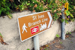 To the trains of the St Ives Branch Line (zawtowers) Tags: cornwall kernow summer holiday break vacation july 2017 carbisbay porth reb tor lelant lannanta south west coast path walk late afternoon rainy wednesday 19th trains st ives bay branch line sign post direction walking downhill