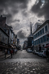 "the storm is coming down rue de Logettes towards Sr Catherine, Honfleur, Normandy, France (grumpybaldprof) Tags: honfleur normandy normandie france calvados storm colour colours dark weather ruedeslogettes building details contrast architectural textures bricks age features wandering streets doors collombage wood timber slate ""halftimbered"" oak plaster traditional norman imppresionist impressionistic fineart hdr ""eglisesaintecatherine"" ""stcatherine'schurch"" 'timberbuilt"" ""largesttimberbuiltchurchinfrance"" ""15thcentury"" ""hundredyears'war"" ""foretdetouques"" ""belltower"" ""separatebelltower"" cobbles mood atmosphere moody threat canon 70d ""canon70d"" tamron 16300 16300mm ""tamron16300mmf3563diiivcpzdb016"""
