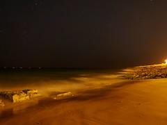 En la inmensidad de la noche (jantoniojess) Tags: algarve praia praiadaluz playa beach sand sea fotografíanocturna portugal largaexposición longexposure panasoniclumixlx100 olas waves lagosportugal night noche nocturno rocasplaya