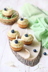 Lime Cupcakes with Blueberry Filling (Мiuda) Tags: cake cakes cupcake cupcakes cup teatime baking baked bake sweet sweetbaking pastry lime rustic white wooden stilllife food foodphotography foodphoto foodblog foodblogger blueberry summer celebration delicious dessert