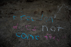 Freedom does not come free (Resad Adrian) Tags: freedom chalk writing message handwriting concrete