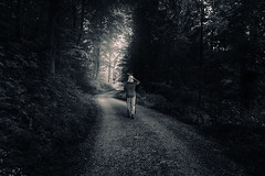 Through the Darkness (HatCat Photography) Tags: landscape fog people nature tree road adult parent child wood dark kid one loneliness panoramic exploration outdoors action solitude remote transportation system