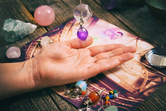 Palm reading, characterization and foretelling the future through the study of the palm with pendulu (Psychic Base) Tags: advisor auspice background bode candle chirology chiromancy clairvoyance clairvoyant closeup dark destiny divination energy esoteric esoterism fingers foretelling fortune fortunetelling fortuneteller future hand interpretation life lines magic magical medium mystery mystic mystical palm palmist palmistry paranormal pendulum portend prediction prophecy psychic reader reading sorcerer table teller telling woman
