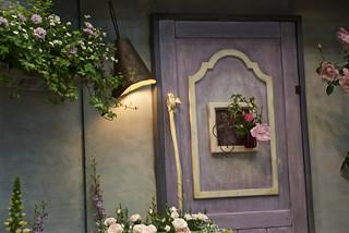 Lavender door lit by lamp