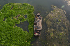 Travelling between two different world!! (ashik mahmud 1847) Tags: bangladesh boat d5100 nikkor river water green people aerial aerialview travelling transport