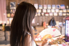 Young woman shopping in traditional Japanese retail store, holding paper fan (Apricot Cafe) Tags: img39190 2024years asia asianandindianethnicities japan japaneseethnicity japaneseculture katoricity sawarakatori sigma35mmf14dghsmart beautifulwoman blackhair candid carefree charming cheerful chibaprefecture colorimage cultures customer day enjoyment happiness holding horizontal indoors lifestyles longhair oneperson onlyjapanese onlywomen onlyyoungwomen paperfan people photography realpeople retail retailstore shopping sideview smallbusiness smiling store success sunlight sustainablelifestyle tourism tourist traveldestinations waistup women youngadult katorishi chibaken jp