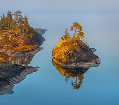 The Golden Island (fedorlashkov) Tags: sunrise forest island rocks summer evening calm peaceful shore sundown waterscape magenta tranquil pines afterglow blue hour bluehour lakeside burning sky water reflection lakescape photo tour after sunset languedoc redsky skerries hours karelia nisi lake ladoga