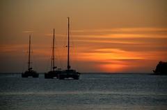Après le soleil (¡! Nature B■x !¡) Tags: landscape seascape naturephotography sun sunset boat blue orange sky sea img1720 nature france antilles martinique coucherdesoleil mer plage caraïbes caribbean