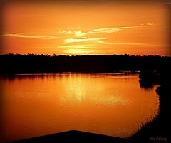 Super Dooper Sunset! (Chris C. Crowley- Always behind but trying to catc) Tags: superdoopersunset sprucecreekpark portorangeflorida sunset clouds sky sun reflections creek sprucecreek water wetlands