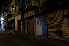 """""""i'll be watching you"""" (hugo poon - one day in my life) Tags: xt2 23mmf2 hongkong saiyingpun firststreet myfamiliarplaces vanishing citynight home eyes vacant shop solitude dark goodnight"""