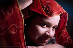 Portrait (Sanhita Bhattacharjee) Tags: sanhitabhattacharjee tripura india portrait flickrfriday flickr google photography 121click nationalgeography red explore betterphotography tripuraindia nikon nikkor50mm18g nikkor nikond7000 smile night