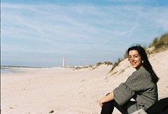 (João Alegria.) Tags: girl beach analogic film analog sea lighthouse outdatedfilm warm colours