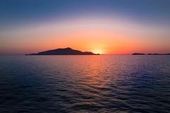 Sunset behind an island (R.Halfpaap) Tags: island sun sunset italy red blue nature ocean sea coast amalfi capri sorrento sorrent italia italien