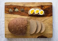 Sweet Limpa, a recipe from Sweden (Chase Hoffman) Tags: denver colorado color chasehoffmanphotography chasehoffman summer food bread heartybread bake baking loaf rye ryebread cuttingboard topdown fujifilm fujifilmxt10 fuji fujinonxf23mmf14r wideangle limpa siraplimpa swedishlimpa swedishrye egg eggs hardboiledeggs hardboiledegg