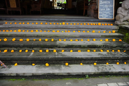 Stairs decorated with orange flowers in Ubud, Bali
