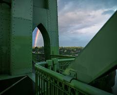 Rainbows around the corner (Zeb Andrews) Tags: stjohnsbridge bridge rainbow portland oregon pacificnorthwest storm filmisnotdead kodakektar100 6x7 mediumformat urban cityscape