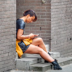 Beautiful alternative girl (sander_sloots) Tags: girl alternative fashion rotterdam leather dress phone boots meisje vrouw lady alternatief beautiful tattoo laarsjes telefoon earring noordsingel bergweg noord dame aantrekkelijk candid oorbel bricks brickwall portiek bakstenen mode leder jurk leer skirt