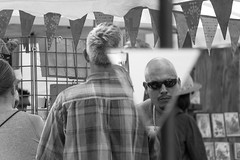 A moment with two dimensions (RaminN) Tags: monochrome triangle oregon portland pdx saturdaymarket people reflection mirror