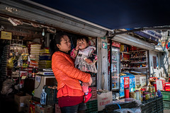 mum the shopkeeper- people of Shanghai (Rob-Shanghai) Tags: shanghai china kids mother child shop shopkeeper leica leicaq street