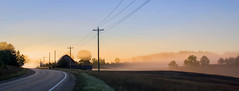 A Ride in the Morning Mist (T P Mann Photography) Tags: sunrise sunlight sunlit barn road fields mist fog nature rural land landscape sun golden color sky clear blue power lines powerlines shadows light trees country countryside breezeway east jordan boyne city michigan drive ride pano panoaramic canon t3i eos dslr morning dusk dawn