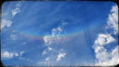 Sundog through the porthole. (coalhole2) Tags: oneplus5 snapseed rainbow sundog sky clouds