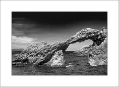 The Arch of Portitxol, l'Escala (SK Monos) Tags: monochrome landscape seascape catalonia spain sea water rocks arch canon eos natural formation