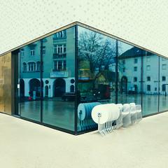 At The Corner (Blue Rain) (macplatti) Tags: agfacolor alienskinsoftware blue corner white bregenz glass window cafe chairs tablesstapled staple vorarlberg austria aut